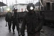 Chinese workers prepare to rescue trapped colleagues from the Shuanfeng coal mine in 2011. About 40 miners were trapped underground after a coal mine tunnel collapsed in southwest China, state media said