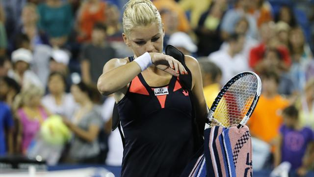 US Open - Radwanska dumped out, refuses to blame grandfather's death