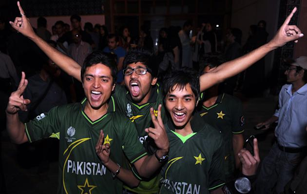 Pakistani cricket fans celebrate the Asia Cup victory in Karachi on March 22, 2012. Pakistan recorded a thrilling two-run victory over Bangladesh in a dramatic final to take the Asia Cup tournament in