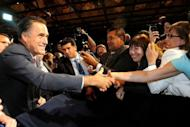 Republican presidential candidate Mitt Romney greets supporters June 21, in Lake Buena Vista, Florida. US President Barack Obama, renowned as a champion fundraiser who piled up $750 million in 2008, warned supporters he would be outspent by Romney in this year's election