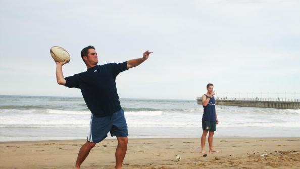 13 Mar 2002:  Mark Boucher of South Africa joins the other cricketers playing touch rugby on the beach in Durban, South Africa. DIGITAL IMAGE.  Touchline photo images are available to clients in UK, USA and Australia only  Mandatory Credit: Touchline Photo/Getty Images
