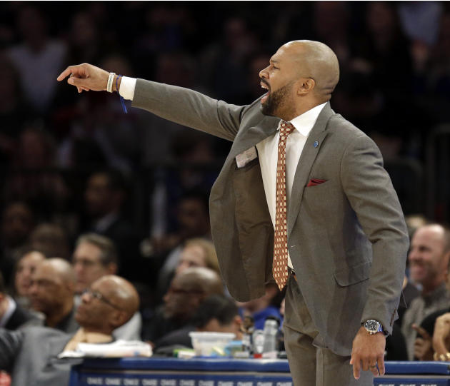New York Knicks head coach Derek Fisher talks to his players during the second half of the NBA basketball game against the Denver Nuggets, Sunday, Feb. 7, 2016, in New York. The Nuggets defeated the K