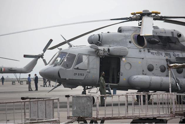 An Indian army helicopter is parked on the tarmac of the Kathmandu international airport the day after a massive earthquake devastated the region, in Kathmandu, Nepal, Sunday, April 26, 2015. Indian a