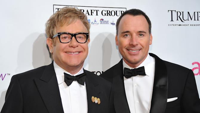 "FILE - In this Oct. 18, 2010 file photo, Sir Elton John, left, and David Furnish attend the Ninth Annual Elton John AIDS Foundation benefit 'An Enduring Vision' at Cipriani Wall Street in New York. Elton John and David Furnish say they have become parents for a second time. The couple say they are ""overwhelmed with happiness"" at the birth of Elijah Joseph Daniel Furnish-John. John's spokeswoman Fran Curtis confirmed an announcement on the singer's website that the baby was born Friday Jan. 11, 2013 in Los Angeles to a surrogate mother, weighing 8 pounds, 4 ounces (3.7 kilograms). (AP Photo/Evan Agostini, File)"