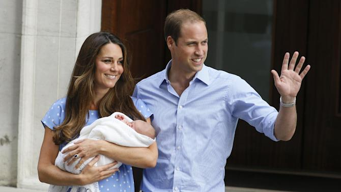 Britain's Prince William, right, and Kate, Duchess of Cambridge, hold the Prince of Cambridge, Tuesday July 23, 2013, as they pose for photographers outside St. Mary's Hospital exclusive Lindo Wing in London where the Duchess gave birth on Monday July 22. The Royal couple are expected to head to London's Kensington Palace from the hospital with their newly born son, the third in line to the British throne. (AP Photo/Kirsty Wigglesworth)