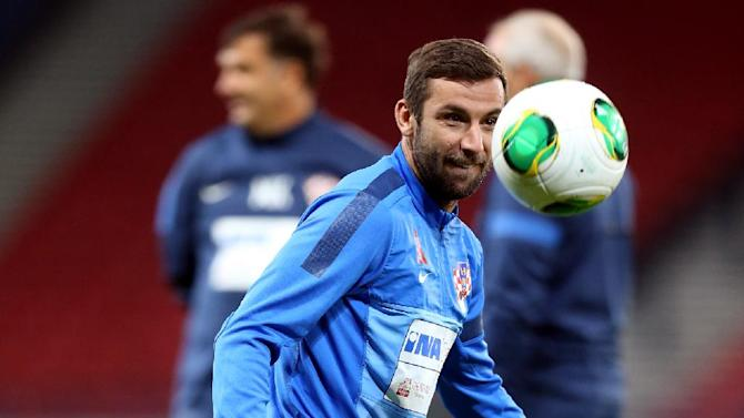 Croatia's captain Darijo Srna controls the ball during a team training session at Hampden Park, Glasgow, Scotland, Monday Oct. 14, 2013. Croatia face Scotland in a World Cup qualifying Group A  soccer match on Tuesday