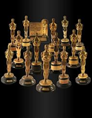 """Handout photo from Nate D. Sanders auction house shows a collection of 15 Oscar statuettes that were auctioned off for more than $3 million on February 28. Highlights of the collection include a Best Screenplay Academy Award for the iconic movie """"Citizen Kane"""", given to Herman Mankiewicz in 1941"""