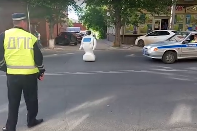 A crafty robot was able to escape the clutches of scientific research and make a dash for freedom outside a research lab in Perm, Russia on Tuesday. The robot, named Promobot, was being taught to move around on its own when a worker reportedly left a gate open. Promobot traveled about 164 feet, stopping in a nearby street when its battery ran out, the BBC reported. SEE ALSO: Jerk human beats up Boston Dynamics robot An alternative theory is that the robot was fed up with its human overlords and decided to end its life in protest by standing in traffic.Maybe it heard about the abusive conditions at Boston Dynamics.  But some Russian media is skeptical, claiming that this was just a clever marketing stunt to garner attention for the humanoid robot. After all, the Promobot company did post a video of the incident to its YouTube channel.  In the video, a police officer rolls up to the spot where the robot is blocking traffic, and a few moments later a man moves Promobot out of the street. Russian media reported thatthe robot was in the road for approximately 30 minutes before it was retrieved.  According to the company, the robot is designed to talk to people, help them with navigation and answer questions. Bonus: Corgi butts in slow motion