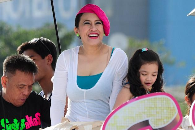 "Actress Ai-Ai Delas Alas is seen at the float of the MMFF 2012 entry ""Sisterekas"" during the 2012 Metro Manila Film Festival Parade of Stars on 23 December 2012.(Angela Galia/NPPA images)"