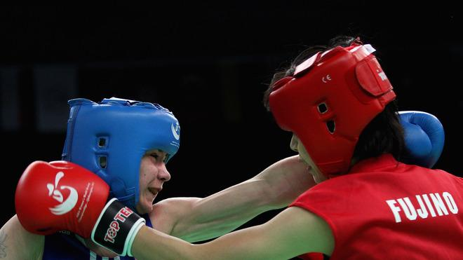 Chinase Fujino (Red) Of Japan Fights Against Aleksandra Kuleshova (Blue) Of Russia In The Women's 54kg Preliminary Getty Images
