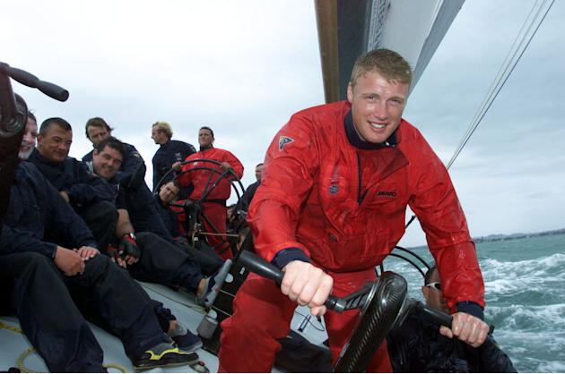 22 Feb 2002:  England players (in red) Andrew Flintoff (right) and Darren Gough (centre) have a trip on the boat used for the GBR Challenge for the America's Cup in Auckland harbour, Auckland, New Zea
