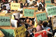 Local residents are seen here during a rally in Wukan, a fishing village in the southern province of Guangdong on December 17. Protesting villagers say they will march on government offices this week unless the body of a local leader is released and four villagers in police custody are freed