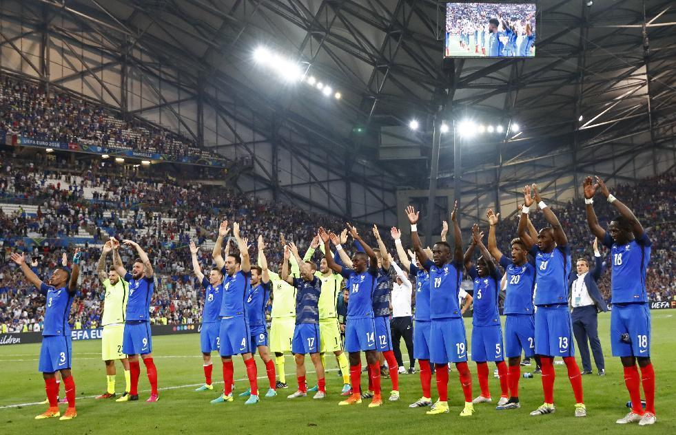France players celebrate with fans at the end of the match