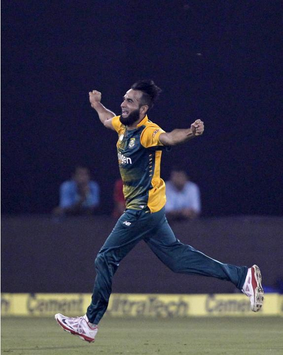 South African's Imran Tahir celebrates after dismissing India's Suresh Raina during their second Twenty20 cricket match in Cuttack