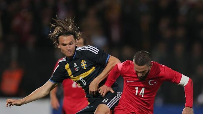 Turkey's Arda Turan, left, vies with Sweden's Albin Ekdal during their International Friendly soccer match at 19 Mayis Stadium in Ankara, Turkey, Wednesday, March 5, 2014.(AP Photo)