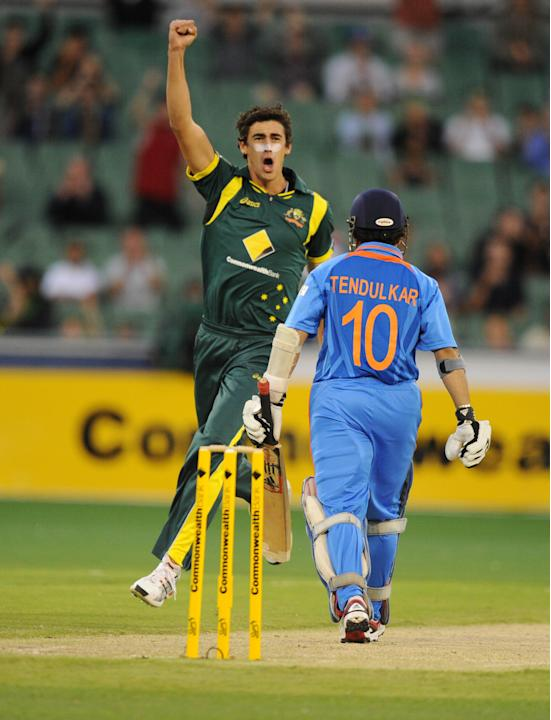 Australia's Mitchell Starc celebrates the wicket of India's Sachin Tendulkar, right, after he was caught by Ricky Ponting during their one day international cricket match at the MCG in Melbourne. Aust
