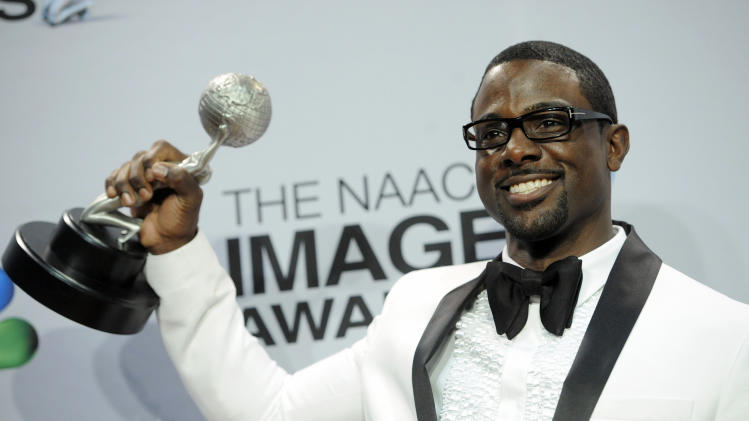 "Lance Gross poses backstage with the award for outstanding supporting actor in a comedy series for ""Tyler Perry's House of Payne"" at the 44th Annual NAACP Image Awards at the Shrine Auditorium in Los Angeles on Friday, Feb. 1, 2013. (Photo by Chris Pizzello/Invision/AP)"