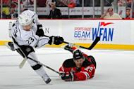 Los Angeles Kings' Dustin Brown (L) fires the puck as New Jersey Devils' Mark Fayne defends during game one of their NHL Stanley Cup Final on May 30. Fayne missed an open shot with little more than 10 minutes remaining