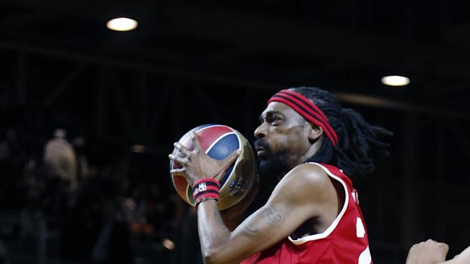 West's Snoop Dogg, aka Snoop Lion, drives to the basket in the second half as he participate in an NBA All-Star Celebrity basketball game against East in New Orleans, Friday, Feb. 14, 2014. East won 60-56