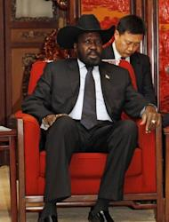 "South Sudan President Salva Kiir, seen in a meeting with Chinese Vice Premier Li Keqiang, in Beijing. Kiir will cut short his visit to China due to ""domestic issues"", a Chinese official said, as violence between the world's newest nation and Sudan intensified"