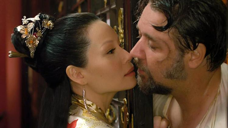 "This image released by Universal Pictures shows Lucy Liu, left, and Russell Crowe in a scene from ""The Man With the Iron Fists.""  (AP Photo/Universal Pictures)"