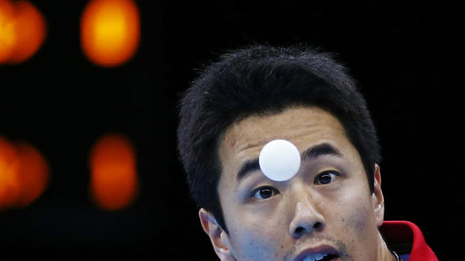 South Korea's Joo Saehyuk serves to Hong Kong's Jiang Tianyi in their men's team semifinals table tennis match at the ExCel venue during the London 2012 Olympic Games