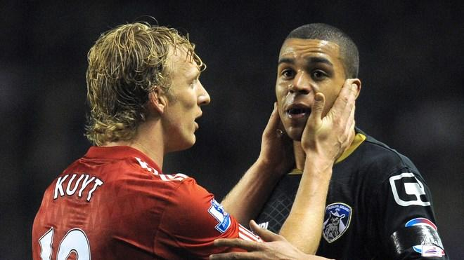 Oldham Athletic's English Midfielder Tom Adeyemi (R) Reacts Next To Liverpool's Dutch Forward Dirk Kuyt  RESTRICTED TO AFP/Getty Images