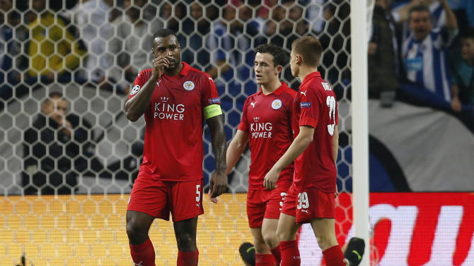 Leicester City's Wes Morgan,  Ben Chilwell and Harvey Barnes look dejected