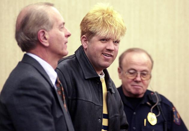 FILE - In this Friday, March 1, 2002 file photo, Todd Hall, 30, center, smiles before leaving court in Ironton, Ohio. With Hall is his attorney J. Michael Evans, left. Hall, accused of starting a 1996