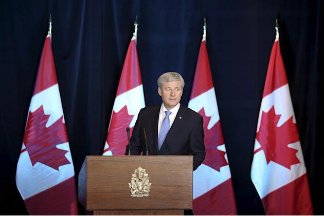 Canada's PM Harper arrives at a news conference on the TPP trade agreement in Ottawa