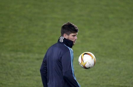 Huntelaar of Schalke 04 plays with a ball during a training session in Prague