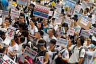 People march during a rally calling on the government to take action against mainland Chinese pregnant mothers using hospital services in Hong Kong in 2011. Hong Kong on Friday warned expectant mothers from mainland China against rushing to emergency wards without prior bookings, saying they were putting their babies' lives at risk