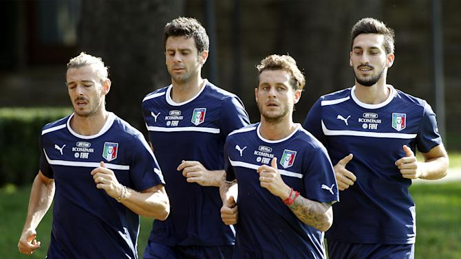 Italian national soccer team players, from left, Federico Balzaretti of A.S. Roma, Thiago Motta of F.C. Paris Saint Germain, Alessandro Diamanti of F.C. Bologna, and Davide Astori of Cagliari Calcio, warm up during a training session with their team at the Coverciano sports center, near Florence, central Italy, Wednesday, Oct. 9, 2013, ahead of a 2014 FIFA World Cup, Group B, qualification match against Denmark in Copenhagen on Friday. Italy, already qualified, will play Denmark aiming to rank second in Group B. Other teams in Group B are, Armenia, Bulgaria, Czech Republic, and Malta