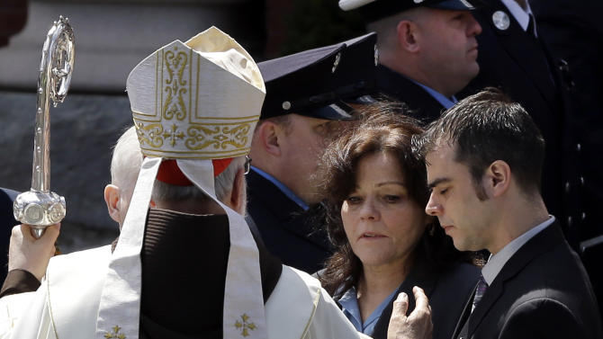 Boston Cardinal Sean O'Malley comforts Patty Campbell and her son, Billy, after a  funeral for her daugher, Krystle Campbell, 29, at St. Joseph's Church in Medford, Mass. Monday, April 22, 2013. Krystle Campbell is one of three victims killed in the Boston Marathon explosions. (AP Photo/Elise Amendola)