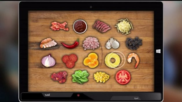 Pizza Hut has introduced a new menu that uses your retina`s gaze to determine what toppings you want.