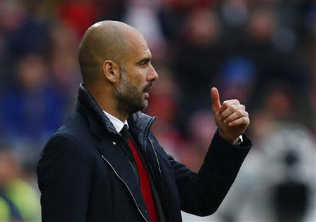 Bayern Munich's coach Guardiola reacts during their German first division Bundesliga soccer match against FSV Mainz 05's during their German first division Bundesliga soccer match in Mainz