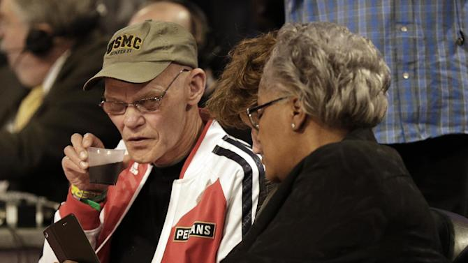 Vice Chairwoman of the Democratic National Committee Donna Brazile, right, speaks with Political commentator and media personality James Carville during the skills competition at the NBA All Star basketball game, Saturday, Feb. 15, 2014, in New Orleans