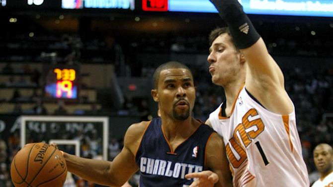Charlotte Bobcats point guard Ramon Sessions (7) drives against Phoenix Suns shooting guard Goran Dragic (1) in the first quarter during an NBA basketball game on Saturday, Feb. 1, 2014, in Phoenix