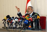 Syrian Information Minister Omran al-Zohbi gives a press conference in Damascus on Sunday. Zoabi, who told reporters he had been unaware of any visit by Lakhdar Brahimi, reiterated calls for national dialogue.