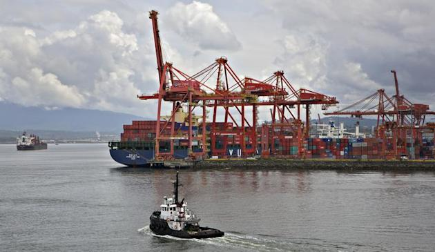 A tugboat heads out into the harbour beside the container port in Vancouver, British Columbia June 8, 2012. REUTERS/Andy Clark
