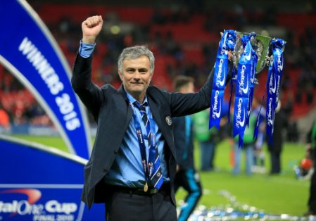 Chelsea manager Jose Mourinho lifts the trophy