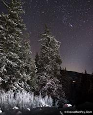 "Astrophotographer Daniel McVey sent in this photo of Orion taken in Colorado, Dec. 11, 2012. He writes: ""Snow covered trees and Orion high in the sky are sure signs that winter has arrived in Summit County, Colorado."" This scene is actually com"