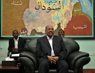 Sudanese President Omar al-Bashir (C) attends a meeting in Khartoum on March 22. Sudanese warplanes on Tuesday launched fresh air raids on oil-rich areas of South Sudan, a Southern official said, as their bilateral relations frayed despite UN chief Ban Ki-moon calling for calm