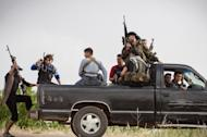 """Members of the Free Syrian Army's """"Commandos Brigade"""" on patrol near Qusayr, on May 10. The UN has condemned mass slaughter near the central town of Houla on Friday and Saturday in which 108 people died, including 49 children and 34 women"""
