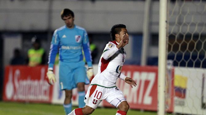 Liga Deportiva Universitaria de Loja's Jonny Uchuari of Ecuador, center right, celebrates after scoring by penalty as Argentina's River Plate goalkeeper Marcelo Barovero watches, in the background, during a Copa Sudamericana  soccer match in Loja, Ecuador, Thursday, Sept. 19, 2013