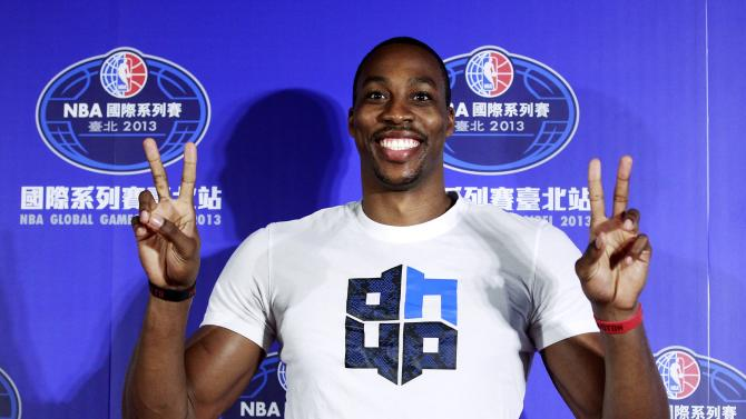 NBA Houston Rockets' Dwight Howard poses for pictures during a news conference in Taipei