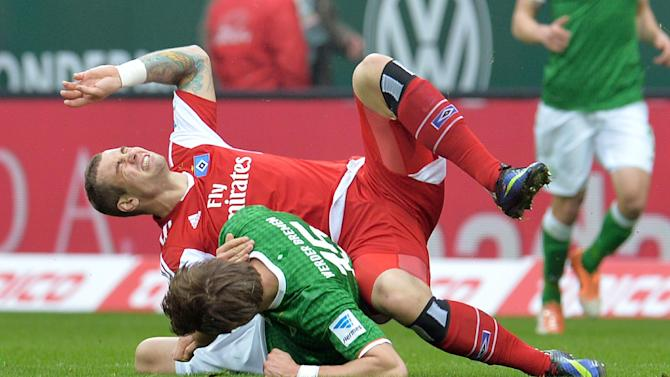 Bremen's Sebastian Proedl and Hamburg's Pierre-Michel Lasogga , top, challenge during the Bundesliga  soccer match between Werder Bremen and Hamburger SV  in Bremen, Germany, Saturday, March 1, 2014
