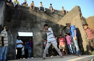 "SlumGods members take part in a dance practice at the Sion fort in Mumbai on November 30, 2012. They want to show there is more to life in a Mumbai shantytown than poverty and squalor -- even if the hit film ""Slumdog Millionaire"" suggested otherwise"