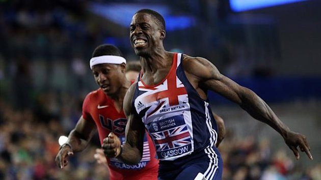 UNITED KINGDOM, GLASGOW : Dwain Chambers (R) of Great Britain crosses the finish line to win the Men's 60m during The British Athletics Glasgow International Match at The Emirates Arena, Glasgow, Scotland, on January 26, 2013. AFP