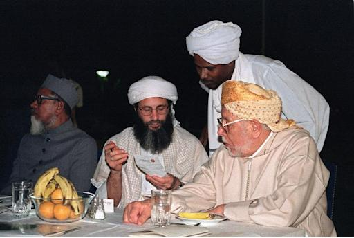Yusuf Islam (centre) at a political and religious conference in Khartoum on December 2, 1993